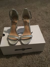 pair of gray platform open-toe ankle-strap sandals with box