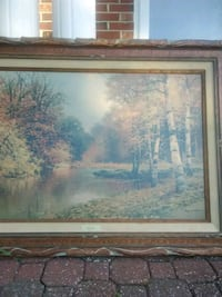 brown wooden framed painting of river St. Peters, 63304