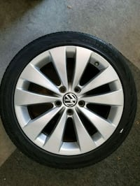 chrome Volkswagen multi-spoke wheel with tire Laval
