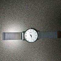 round silver analog watch with black leather strap Calgary, T3J 5M7