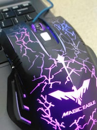 purple and black Magic Eagle corded computer mouse West Falls Church