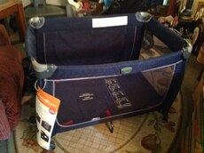 baby's blue and black play pen
