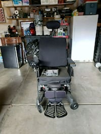 black and gray motorized wheelchair Aurora, 80013