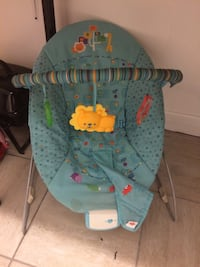 baby's blue and green bouncer Montréal, H3M 2X5
