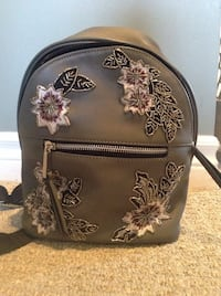 brown and black floral backpack Hamilton, L8T 4K6