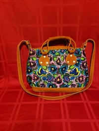 New handbag with hand stitched flowers.