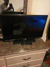 black flat screen TV with remote Springfield, 01108