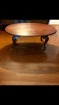 Round brown wooden coffee table Tampa, 33611