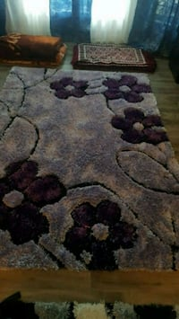 brown and black floral area rug Chestermere, T1X 1S5