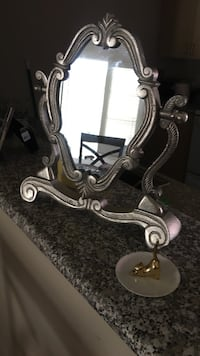 silver-colored wooden framed mirror