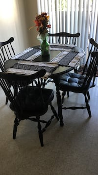 Oval black wooden table