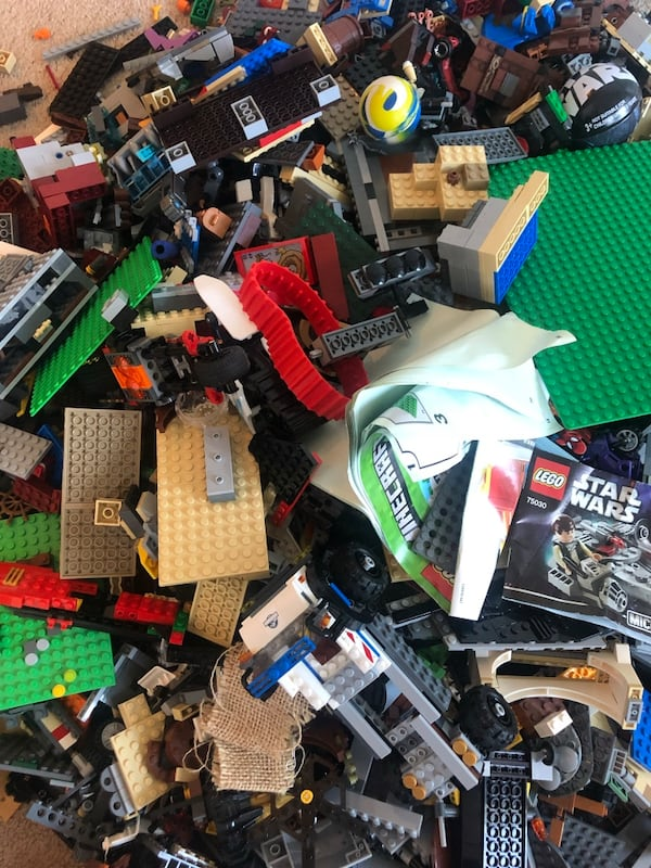Bin of LEGOs including pieces to Star Wars, Harry Potter, etc f129494a-e06a-475a-b851-6dbef18ce3f3