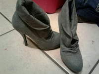 pair of black leather heeled booties