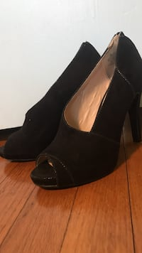 pair of women's black suede peep-toe chunky heels