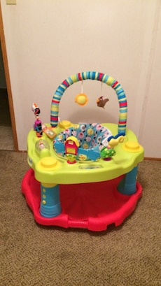 baby's green, red, and blue activity saucer