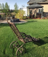 Cross posted. Purchased in Wales, this Victorian stroller  is in great shape considering it's age. (late 1800's). It's dark brown in colour. Wheels are metal, and body is wicker. Doesn't appear to have any cracks in the wicker. Wheels rotate. Calgary, T3H 5Y5