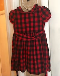 girl's black, grey, and red plaid dress