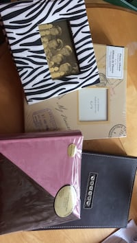 Four photo albums in various sizes