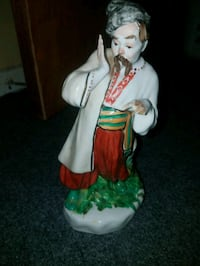 man raise right hand ceramic figurine