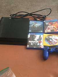 black Sony PS4 with controller and game cases Washington, 20019