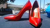 pair of red patent leather pointed-toe pumps Huntington Beach, 92646