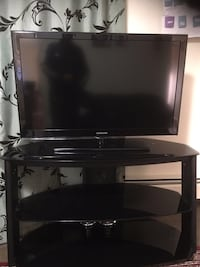 black flat screen TV with black wooden TV stand