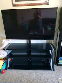 """65"""" LG 4K SMART TV and tv stand/mount."""