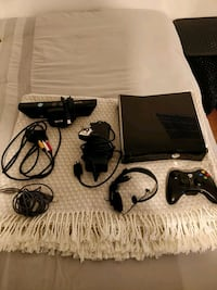 black Xbox 360 console with controller