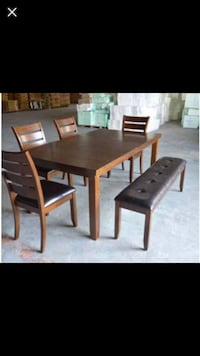 rectangular brown wooden table with six chairs dining set Bossier City, 71112