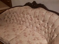 brown wooden framed white padded armchair North Vancouver, V7M