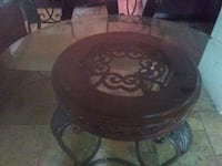 Glass top table and chairs wrought iron with Rosew Daytona Beach, 32118