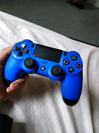 blue and black Sony PS4 controller Gaithersburg, 20886