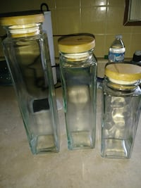 three clear glass bottles