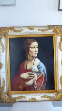 """Lady with an Ermine"" oil painting in heavy gold frame 23 mi"