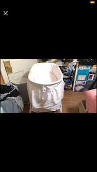Size 1 diapers & Used Bassinet