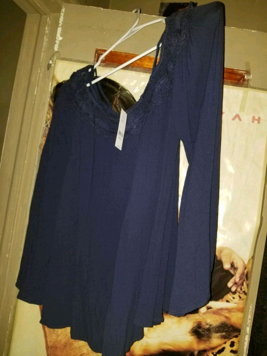 Photo Brand new navy blue shirt. New York and Company. With tags. Size M.