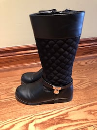 Pair of black leather MK boots
