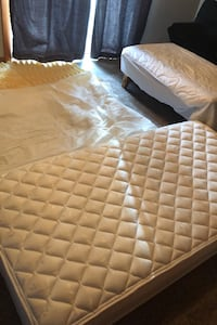 Twin mattress with protective waterproof mattress pad and memory foam.