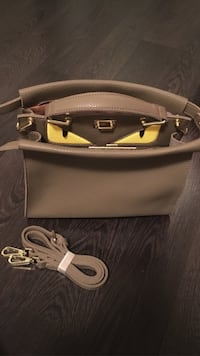 Olive-grey Monster eyes two-way handbag