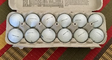 One dozen Titleist ProV1 golf balls