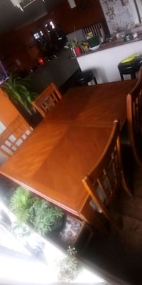 Dining room table with 6 fabric bottom chairs & removable leaf.