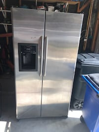 GE 25.0 Cu. Ft. Stainless Side-By-Side Refrigerator with Dispenser Houston