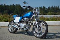 blue and black cruiser motorcycle 3731 km