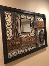 Wrought iron wall art with mirror