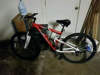 red and black full suspension mountain bike Hitchcock, 77563