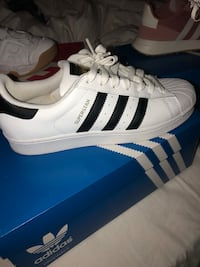 pair of white adidas Superstar shoes with box Milwaukee, 53227
