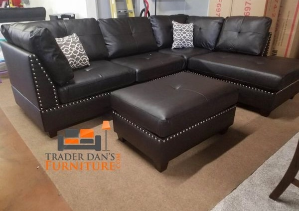 Brand new bonded leather sectional sofa with ottoman  5bb0c666-1132-4aba-92bd-656ee2fe2852