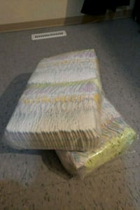 white and yellow disposable diaper pack 1967 km