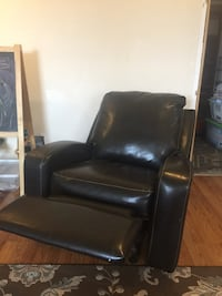 Brown leather rocker recliner like new.