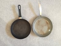 Two frying pans. One is a Greenspan Fairfax, 22032